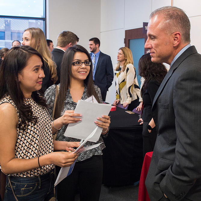 Students at a Graduate School event